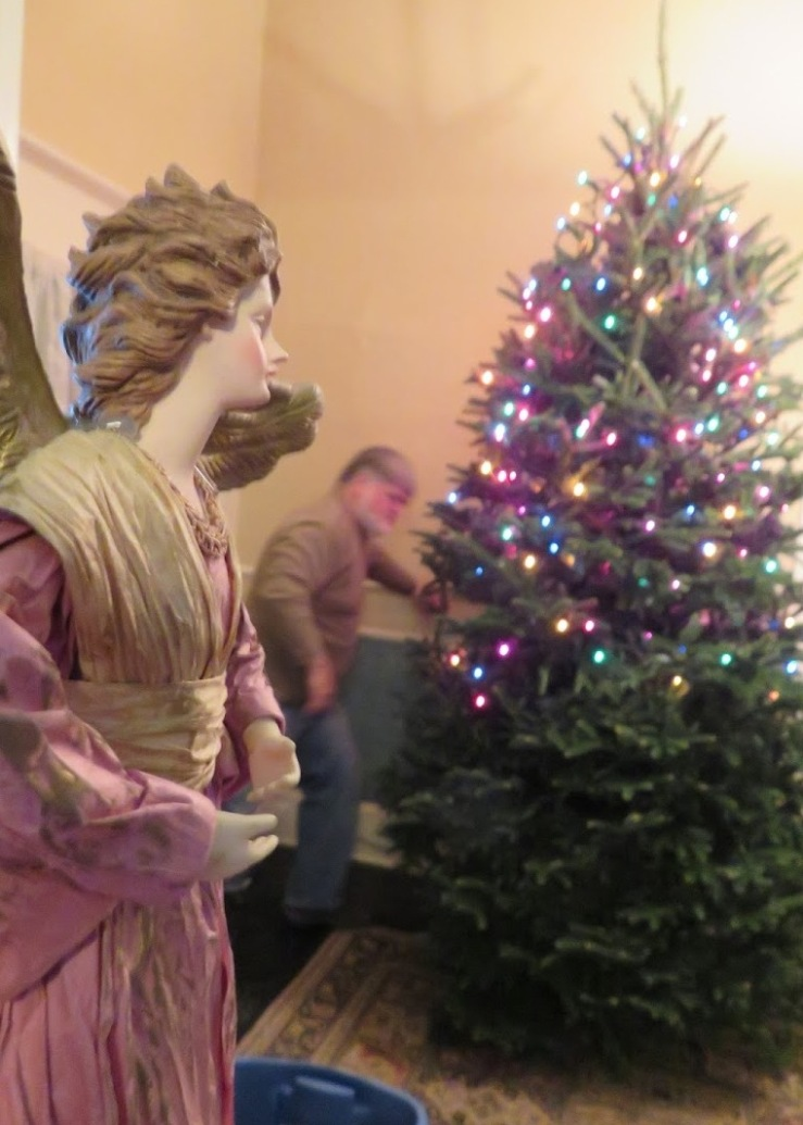 angel overlooks the decorating